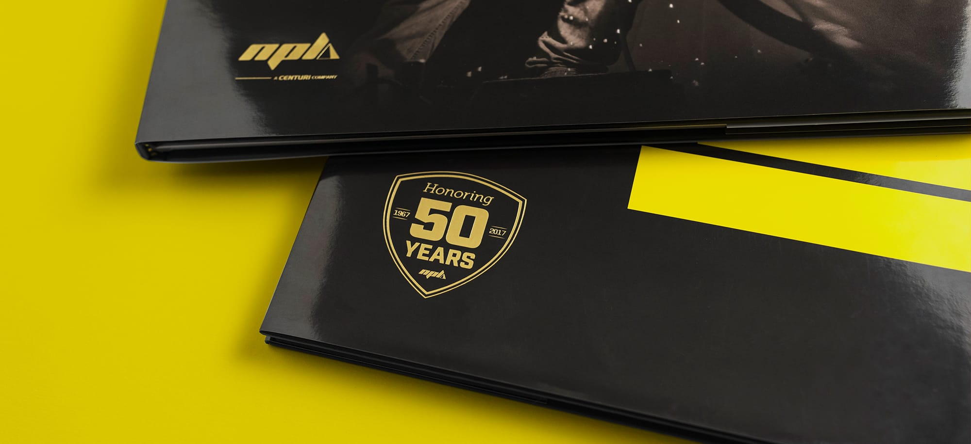 Gold foil detail on NPL anniversary book cover